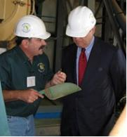 Steve Flick shows Secretary Vilsack biomass pellets